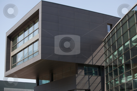 Fragment of a modern building stock photo, Fragment of a modern black building against blue sky by Natalia Macheda