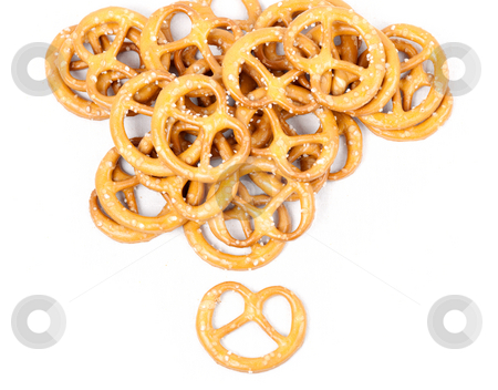 Heap of pretzels stock photo, Heap of crunchy snacky pretzels on white canvas by Natalia Macheda