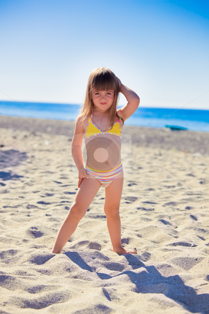 Funny girl on a beach stock photo, Funny little girl wearing swimsuit on a beach by Natalia Macheda