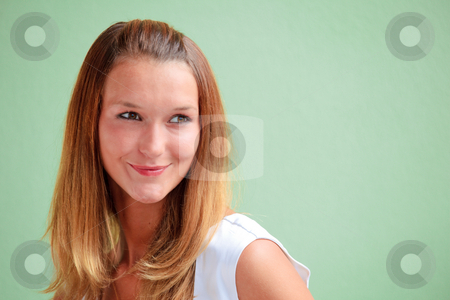 Tanned beauty stock photo, Beautiful redhead woman on a green background with copy-space by Natalia Macheda