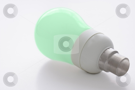Light bulb stock photo, Low energy consumption light bulb, isolated against a white background. Green glass symbolizing