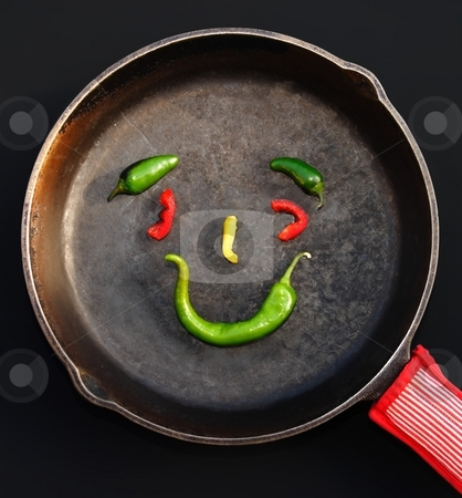 Fun Food stock photo, Three green jalapeno peppers, two red pepper slices, and one yellow pepper slice arranged in a happy face for fun. by Great Divide Photography