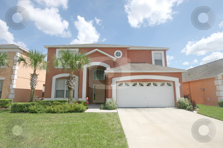 Large Florida Home stock photo, A front exterior of a large florida home by Lucy Clark
