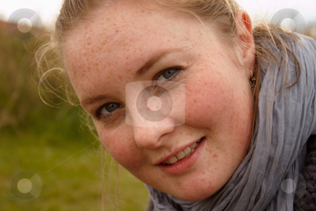 Portrait of a cute young woman looking  stock photo, Portrait of a cute young woman looking at you by Phillip Dyhr Hobbs