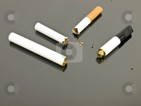 Electronic cigarette and analog cigarette stock photo, Electronic cigarette and an analog cigarette on a silver background by John Teeter