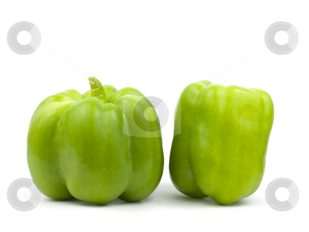 Two green bell peppers stock photo, Two green bell peppers on a white background by John Teeter