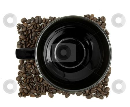 Coffee mug sitting in beans stock photo, Aerial view of coffee mug sitting in beans on white by John Teeter