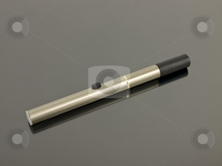 Electronic Cigarette stock photo, Electronic Cigarette with reflection on a silver background by John Teeter