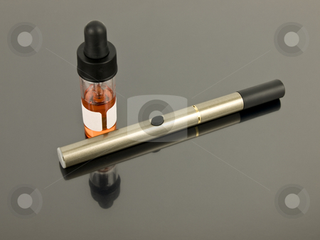 Electronic Cigarette stock photo, Electronic Cigarette with e-juice on silver background by John Teeter