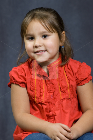 4 Year Old Portrait stock photo, A four year old girl sitting getting her portrait done. by Richard Nelson