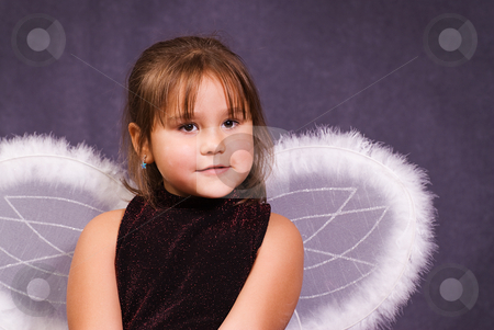 Little Angel stock photo, A little girl pretending to be an angel and wearing wings by Richard Nelson