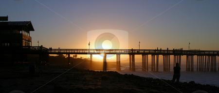 Sunrise Pier Ventura stock photo, The Ventura pier at sunrise at the beach. by Henrik Lehnerer