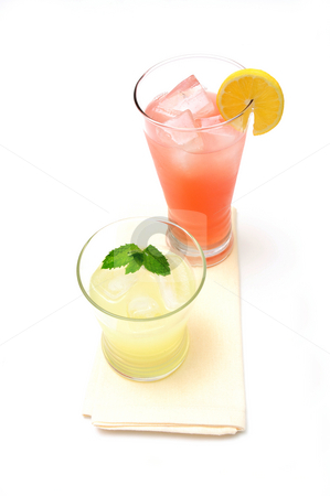 Lemonade stock photo, Two glasses of lemonade, one pink and the other yellow with a slice of lemon and a sprig of mint leaf. by Lynn Bendickson