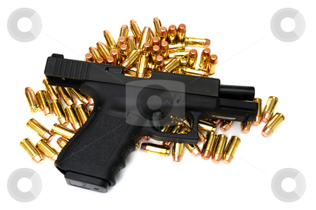 Black Handgun stock photo, A semi automatic pistol with many .40 caliber brass cartridges. The weapon is locked open. by Lynn Bendickson