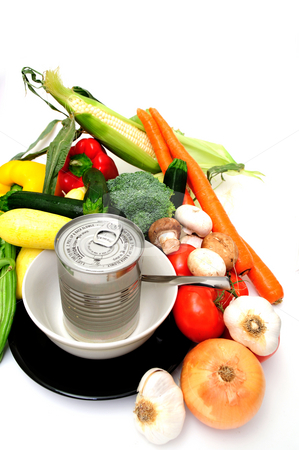 Fresh Or Canned stock photo, Vegetables for vegetable soup including carrot, bell pepper, broccoli, mushroom, squash, garlic, tomatoes or a can of store bought canned soup served in a white bowl on a black saucer by Lynn Bendickson