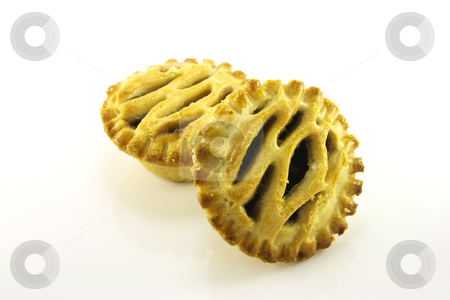 Christmas Sweet Mince Pies stock photo, Two cooked christmas sweet mince pies on a white reflective background by Keith Wilson