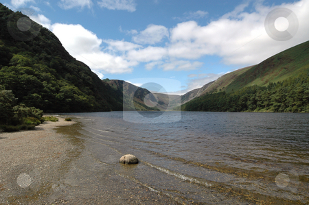 Picturesque lake and mountains stock photo, Scenic view of picturesque lake and mountains in Country Wicklow, Ireland. by Martin Crowdy