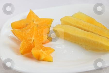 Sliced starfruit stock photo, Sliced starfruit, exotic tropical fruit plate arrangement by Kheng Guan Toh