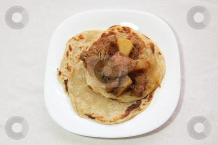 Roti canai prata stock photo, Roti canai prata traditional south indian fried bread, with curry by Kheng Guan Toh