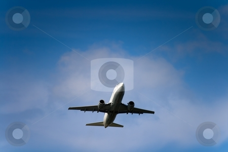 Jet airliner stock photo, Jet airliner against cloudy sky by Interlight