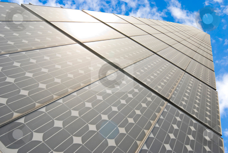 Series of solar energy panels stock photo, Series of solar energy panels under blue sky by Lawren