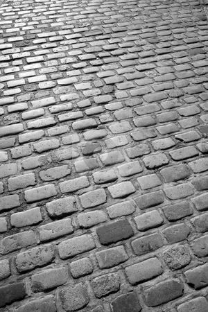 Old English cobblestone road in black and white. stock photo, Old English cobblestone road in black and white. by Stephen Rees