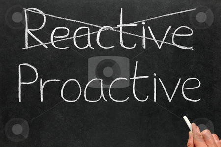 Crossing out reactive and writing proactive on a blackboard. stock photo, Crossing out reactive and writing proactive on a blackboard. by Stephen Rees