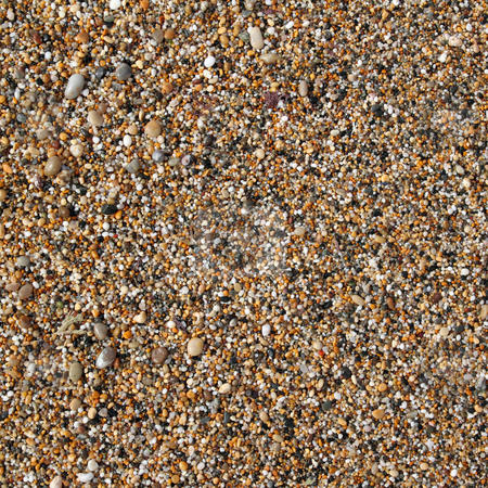 Thousands of small shiny wet colorful pebbles on an English beach. stock photo, Thousands of small shiny wet colorful pebbles on an English beach. by Stephen Rees