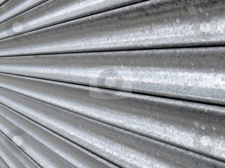 Metal shop security shutter close up. stock photo, Metal shop security shutter close up. by Stephen Rees