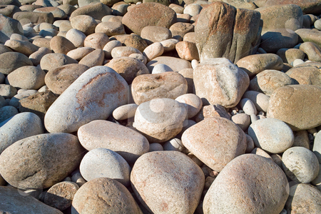 Large granite boulders on the shore in Cornwall UK. stock photo, Large granite boulders on the shore in Cornwall UK. by Stephen Rees