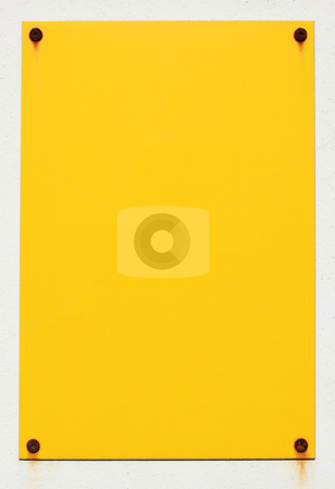 Blank yellow sign stuck to a white wall with rusty screws. stock photo, Blank yellow sign stuck to a white wall with rusty screws. by Stephen Rees