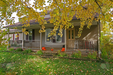 Country Home  stock photo, Country home in fall season and halloween pumpkins by Jack Schiffer
