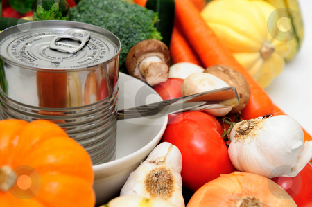 Canned Or Fresh stock photo, Vegetables for vegetable soup including carrot, bell pepper, broccoli, mushroom, squash, garlic, tomatoes or a can of store bought canned soup served in a white bowl by Lynn Bendickson