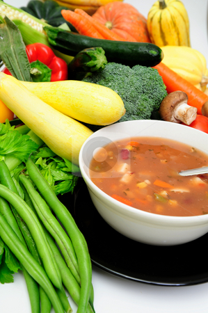 Vegetable Soup stock photo, Vegetable soup in a bowl surrounded by fresh vegetables in cluding squash, carrot, green beans, mushrooms, celery and bell peppers by Lynn Bendickson
