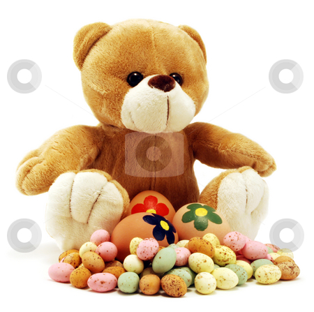 Easter Bear Surrounded By Eggs stock photo, Teddy Bear surrounded by eggs isolated on white by Paul Inkles