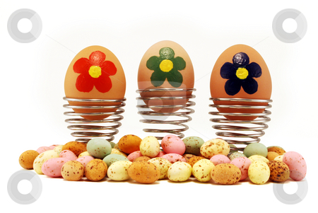 Painted Easter Eggs stock photo, Painted Easter eggs in Cups with clipping path against white by Paul Inkles