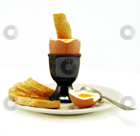 Boiled Egg And Toast stock photo, Boiled Egg with toast inserted on plate against white by Paul Inkles