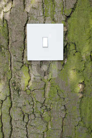 Nature Switch stock photo, Royalty Free Stock Image of a white light switch attached to tree trunk against Bark background in a conceptual manner suggesting Green Power, Prviding Copy space beneath by Paul Inkles