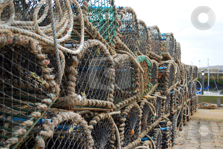 Crab Pots stock photo, Crab pots stacked up in Bridlington Harbour by Paul Inkles