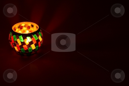 Tea light in a nice holder stock photo, Tea light in a nice holder with much copyspace by Arnold Barna