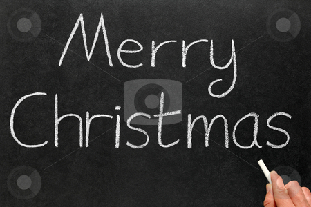 Writing Merry Christmas on a blackboard. stock photo, Writing Merry Christmas on a blackboard. by Stephen Rees