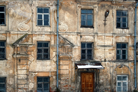 Old wall of a decrepit building stock photo, Wall of an old decrepit dilapidated building. Repair is unprofitable, the structure gradually collapses. by Aleksandr Volokov