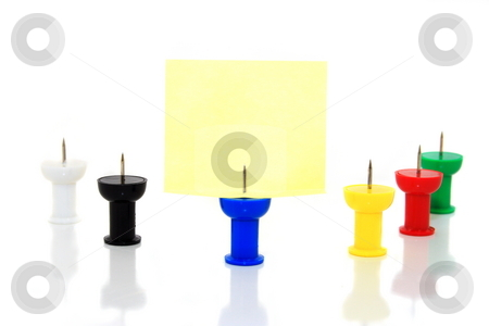 Colored Pushpins stock photo, Assorted colored pushpins on isolated background with yellow message by Jack Schiffer