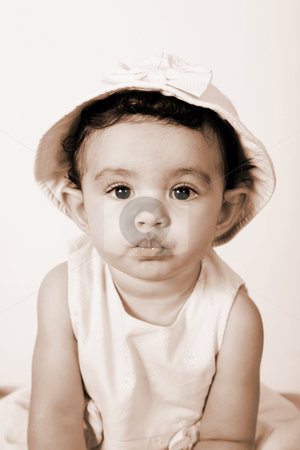 Baby stock photo, Beautiful baby looking at the camera wearing a hat, sepia image by Giuseppe Ramos
