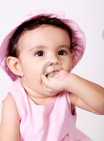 Baby stock photo, Beautiful baby with hand in mouth. White background by Giuseppe Ramos