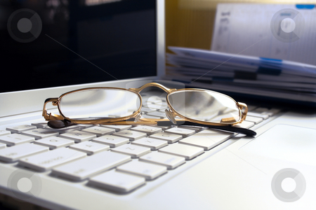 White aptop with glasses. stock photo, Still life - white laptop with glasses. Diary on background.
