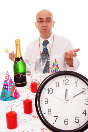 Man at the table stock photo, Lonely man in new year on white background by Jolanta Dabrowska