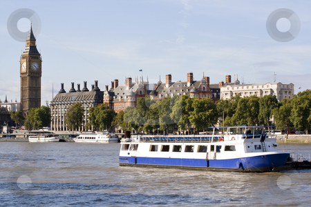 The Big Ben , houses and a boat in the river Thames stock photo, View of The Big Ben, houses and a boat in the river Thames in London by Karel Miragaya