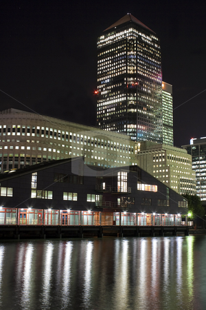 Canary Wharf skyscrapers in London at night stock photo, Canary Wharf skyscrapers in London at night with reflections in the river by Karel Miragaya