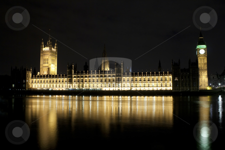 The Big Ben and the Parliament illuminated at night stock photo, The Big Ben and the Parliament illuminated at night with reflections in the river by Karel Miragaya